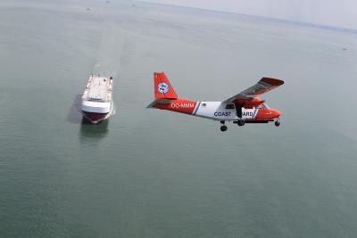 Het Kustwachtvliegtuig OO-MMM in actie. (c) KBIN/BMM