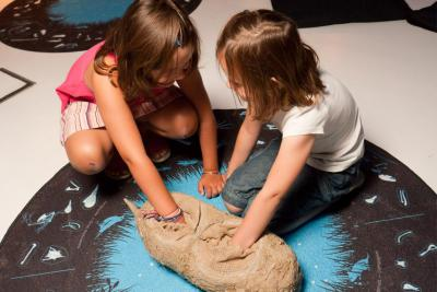 Children analyse the contents of a giant pellet.