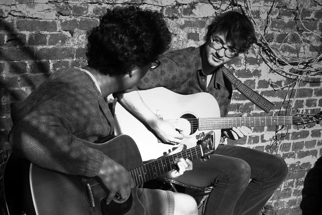 Two guitarists playing