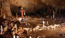 Taking measurements for the archaeo-magnetic survey in the Bruniquel Cave. (Photo: Etienne FABRE - SSAC)